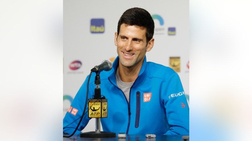 Novak Djokovic, of Serbia, talks to reporters at the Miami Open tennis tournament in Key Biscayne, Fla., Wednesday, March 23, 2016. (AP Photo/Alan Diaz)