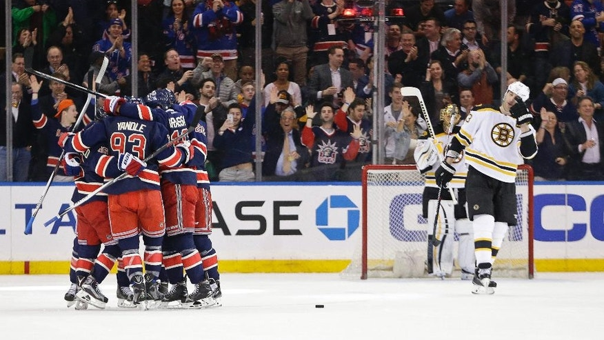 Boston Bruins goalie Tuukka Rask (40) and teammate Zdeno Chara (33) watch as the New York Rangers celebrate a goal by Derek Stepan during the first period of an NHL hockey game Wednesday, March 23, 2016, in New York. (AP Photo/Frank Franklin II)