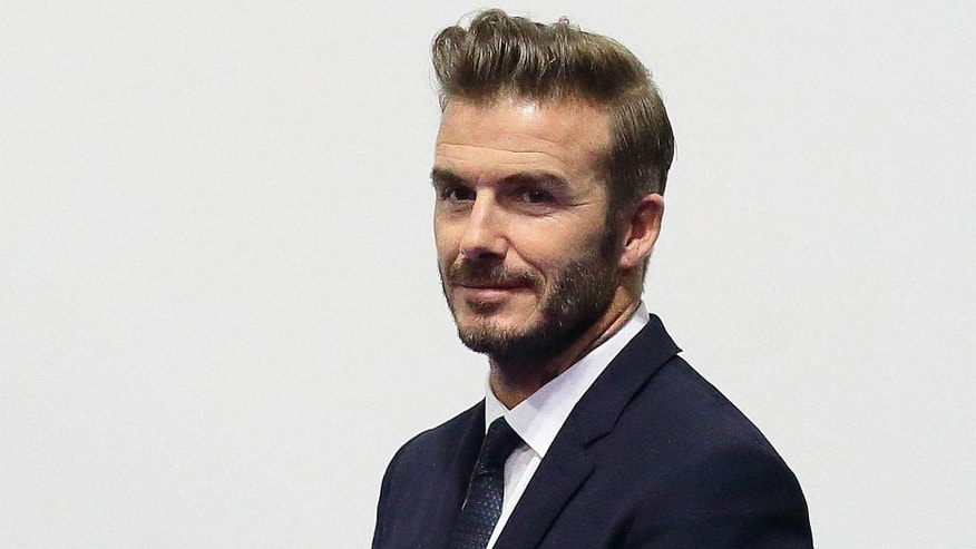 SINGAPORE - DECEMBER 06: English former professional footballer, David Beckham arrives at the Men's Team Football 5-a-Side match between Singapore and Thailand during the 8th ASEAN Para Games 2015 at the Marina Bay Sands Hall on December 6, 2015 in Singapore. (Photo by Suhaimi Abdullah/Getty Images)