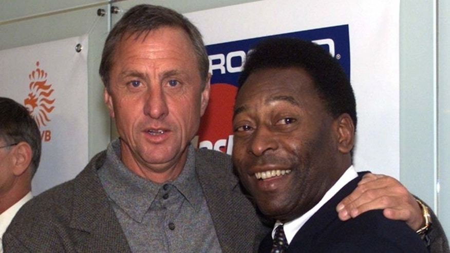 FILE - this is a Friday, Oct. 8, 1999  file photo of Dutch soccer legend Johan Cruyff, left, poses with Brazilian soccer  legend Pele during the a press conference in Amsterdam. Dutch soccer great Johan Cruyff, who revolutionized the game with the concept of 'Total Football,' died Thursday March 24, 2016. He was 68.  (AP Photo/Srdjan Petrovic)