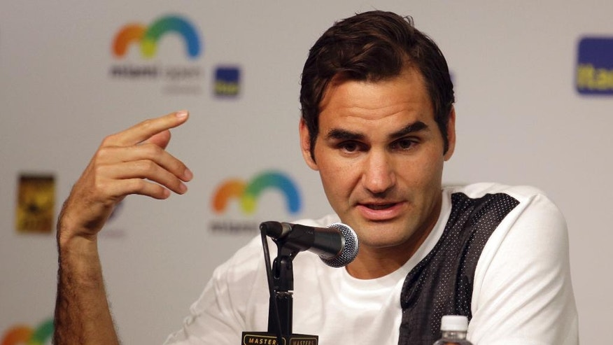 Roger Federer, of Switzerland, responds to a question during a news conference at the Miami Open tennis tournament, Thursday, March 24, 2016, in Key Biscayne, Fla. This is Federer's first tournament since recovering from knee surgery. (AP Photo/Lynne Sladky)