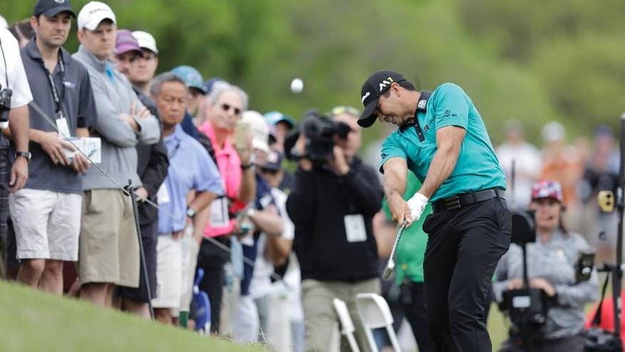 Jason Day, of Australia, hits from the rough on the second hole during round-robin play against Graeme McDowell at the Dell Match Play Championship golf tournament at Austin County Club, Wednesday, March 23, 2016, in Austin, Texas. (AP Photo/Eric Gay)