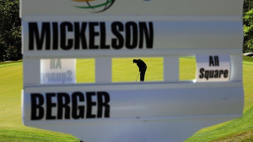 Phil Mickelson putts on the second green during round-robin play against Daniel Berger at the Dell Match Play Championship golf tournament at Austin County Club, Thursday, March 24, 2016, in Austin, Texas. (AP Photo/Eric Gay)