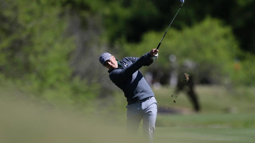 Jordan Spieth hits on the second hole during round-robin play against Victor Dubuisson at the Dell Match Play Championship golf tournament at Austin County Club, Thursday, March 24, 2016, in Austin, Texas. (AP Photo/Eric Gay)