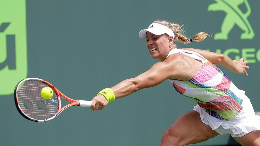 Angelique Kerber, of Germany, returns to Barbora Strycova during a match at the Miami Open tennis tournament in Key Biscayne, Fla., Friday, March 25, 2016. (AP Photo/Alan Diaz)