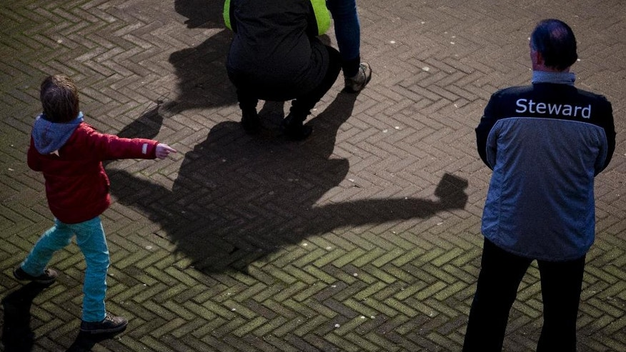 Stewards frisk soccer fans as they enter the ArenA stadium ahead of the international friendly soccer match between The Netherlands and France in Amsterdam, Netherlands, Friday, March 25, 2016. (AP Photo/Peter Dejong)