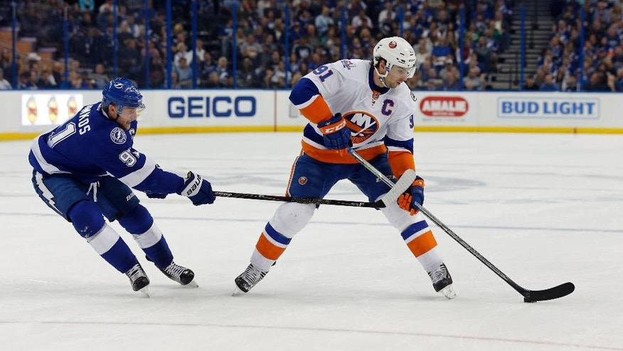 Tampa Bay Lightning's Steven Stamkos, left, defends New York Islanders' John Tavares during the first period of an NHL hockey game Friday, March 25, 2016, in Tampa, Fla. (AP Photo/Mike Carlson)