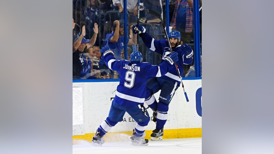Tampa Bay Lightning's Tyler Johnson celebrates a goal with Jason Garrison during the third period of an NHL hockey game against the New York Islanders on Friday, March 25, 2016, in Tampa, Fla. The Lightning won 7-4. (AP Photo/Mike Carlson)