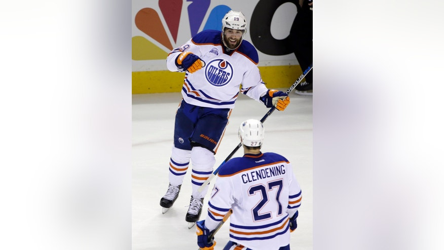 Edmonton Oilers' Patrick Maroon, top, celebrates his goal with teammate Adam Clendening (27) during the second period of an NHL hockey game against the San Jose Sharks Thursday, March 24, 2016, in San Jose, Calif. (AP Photo/Marcio Jose Sanchez)