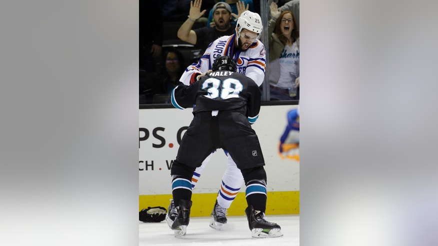 Edmonton Oilers' Darnell Nurse (25) fights with San Jose Sharks' Micheal Haley (38) during the first period of an NHL hockey game Thursday, March 24, 2016, in San Jose, Calif. (AP Photo/Marcio Jose Sanchez)