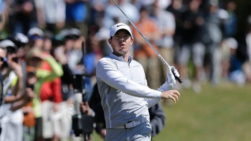Rory McIlroy of Northern Ireland watches his shot on the second hole during round-robin play against Kevin Na at the Dell Match Play Championship golf tournament at Austin County Club, Friday, March 25, 2016, in Austin, Texas. (AP Photo/Eric Gay)