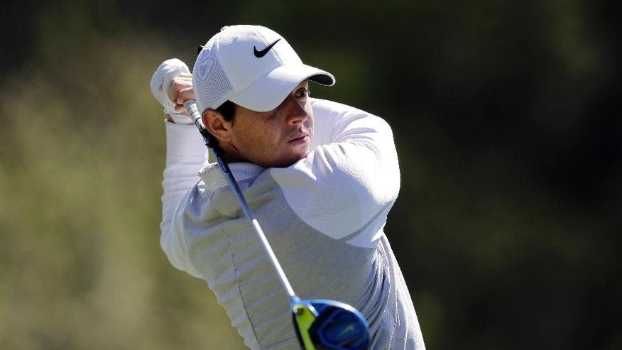 Rory McIlroy of Northern Ireland hits his tee shot on the second hole during round-robin play against  Kevin Na at the Dell Match Play Championship golf tournament at Austin County Club, Friday, March 25, 2016, in Austin, Texas. (AP Photo/Eric Gay)