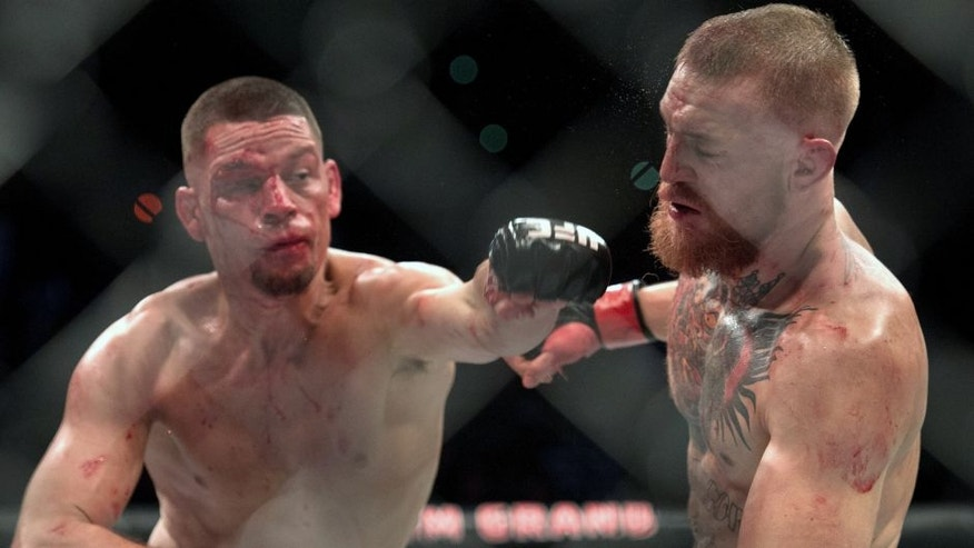 LAS VEGAS, NV - MARCH 5: (L-R) Nate Diaz punches Conor McGregor in their welterweight bout during the UFC 196 in the MGM Grand Garden Arena on March 5, 2016 in Las Vegas, Nevada. (Photo by Brandon Magnus/Zuffa LLC/Zuffa LLC via Getty Images)