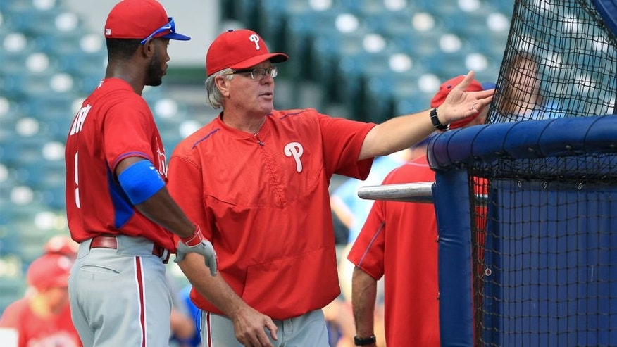 Interim manager Pete Mackanin #45 of the Philadelphia Phillies talks with Domonic Brown #9 during warm ups before their game against the Milwaukee Brewers at Miller Field on August 15, 2015 in Milwaukee, Wisconsin. The Brewers defeated the Phillies 4-2. (Photo by John Konstantaras/Getty Images)