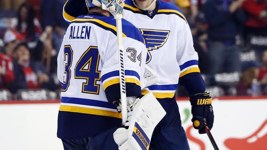 St. Louis Blues goalie Jake Allen (34) celebrates with defenseman Colton Parayko (55) after an NHL hockey game against the Washington Capitals, Saturday, March 26, 2016, in Washington. The Blues won 4-0. (AP Photo/Alex Brandon)