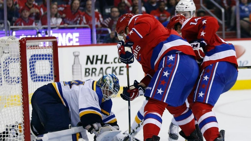 St. Louis Blues goalie Jake Allen (34) stops a shot by Washington Capitals left wing Alex Ovechkin (8), from Russia, with right wing Justin Williams (14) Sweden, nearby, in the third period of an NHL hockey game, Saturday, March 26, 2016, in Washington. AP Photo/Alex Brandon)