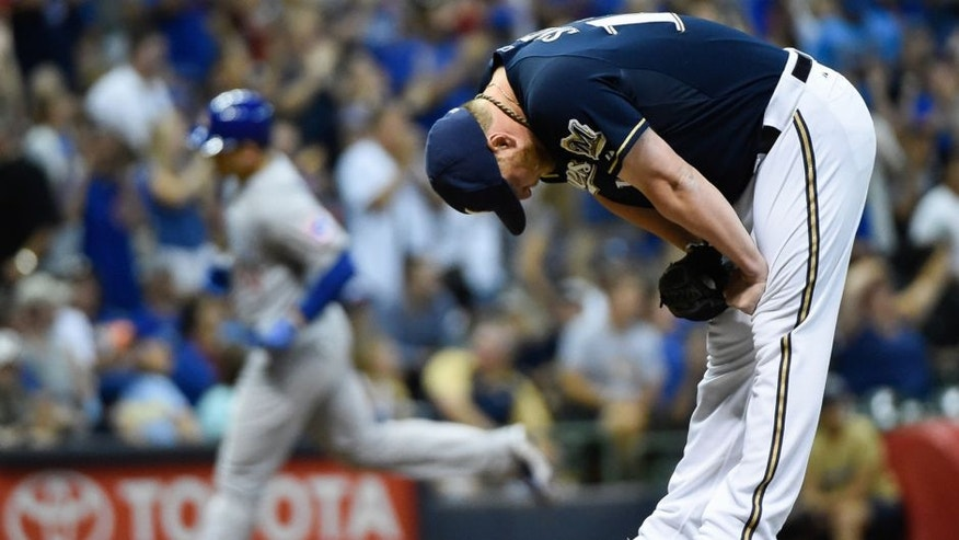 Jul 30, 2015; Milwaukee, WI, USA; Milwaukee Brewers pitcher Will Smith (13) reacts after giving up a 3-run homer to Chicago Cubs first baseman Anthony Rizzo (44) in the eighth inning at Miller Park. Smith was charged with the loss as The Cubs won 5-2. Mandatory Credit: Benny Sieu-USA TODAY Sports