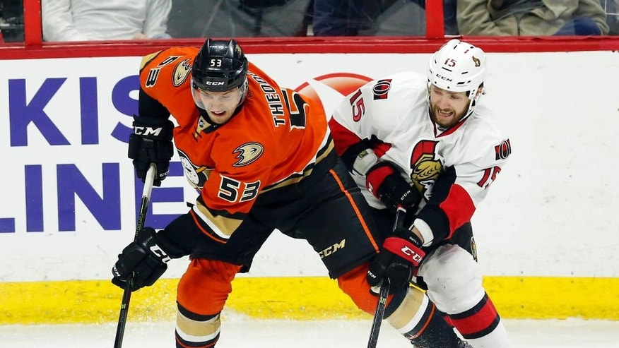 Ottawa Senators' Zak Smith (15) battles for the puck with Anaheim Ducks' Shea Theodore (53) during the second period of an NHL hockey game Saturday, March 26, 2016, in Ottawa, Ontario. (Fred Chartrand/The Canadian Press via AP)