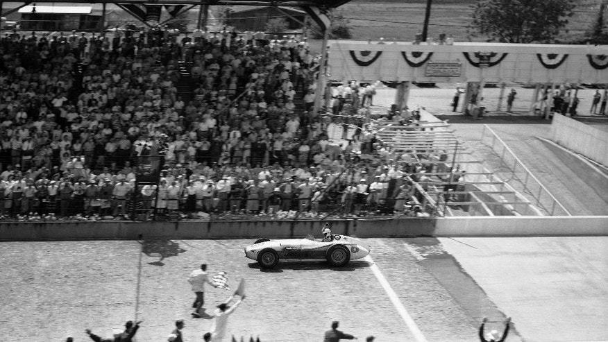 FILE - In this May 30, 1956, file photo, Pat Flaherty, driving a Zing Special, crosses the finish line to win the 40th Indianapolis 500 auto race at Indianapolis Motor Speedway in Indianapolis, Ind. (AP Photo/File)