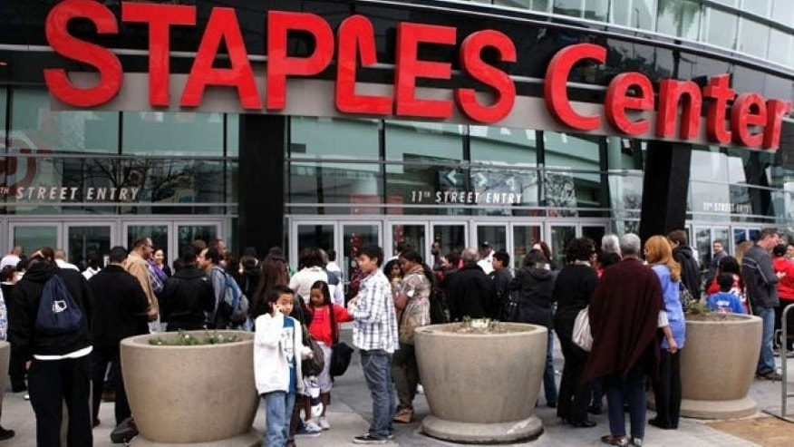 Basketball fans wait outside Staples Center before an NBA basketball game between Los Angeles Clippers and the Cleveland Cavaliers in Los Angeles, Saturday, March 19, 2011.