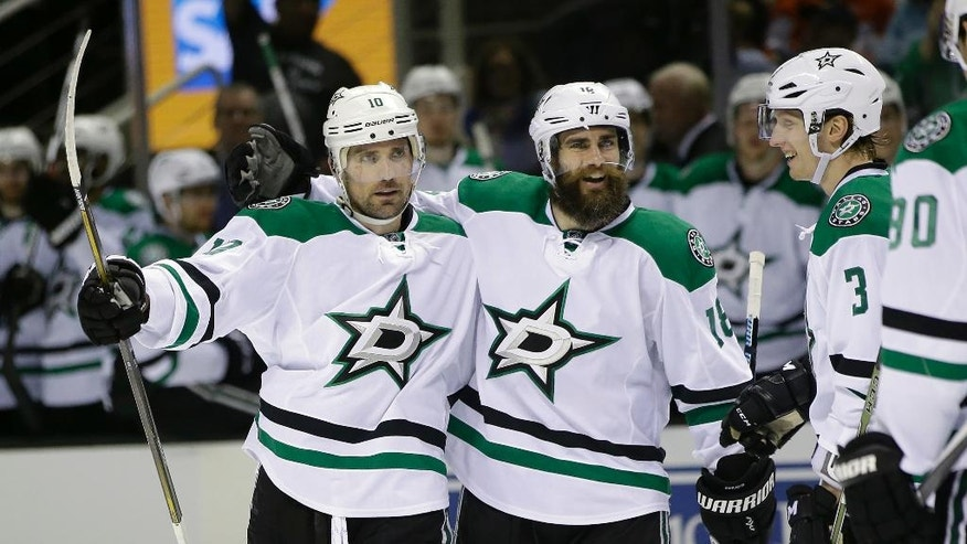 Dallas Stars' Patrick Sharp, left, celebrates his goal with teammates Patrick Eaves, center, and John Klingberg (3) during the second period of an NHL hockey game against the San Jose Sharks, Saturday, March 26, 2016, in San Jose, Calif. (AP Photo/Marcio Jose Sanchez)