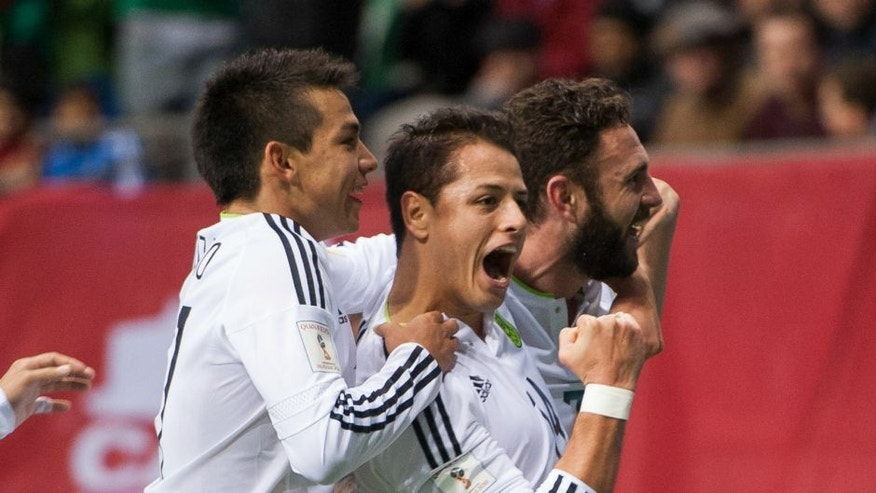 "VANCOUVER, BC - MARCH 25: Javier ""Chicharito"" Herhandez #14 of Mexico is congratulated by teammates Javier Aquino #11 and Miguel Layun #7 of Mexico after scoring a goal against Canda during FIFA 2018 World Cup Qualifier soccer action at BC Place on March 25, 2016 in Vancouver, Canada. (Photo by Rich Lam/Getty Images)"