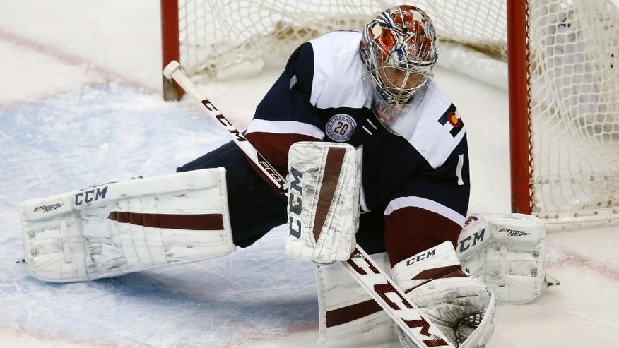 Colorado Avalanche goalie Semyon Varlamov, of Russia, makes a stick save against the Minnesota Wild in the first period of an NHL hockey game Saturday, March 26, 2016, in Denver. (AP Photo/David Zalubowski)