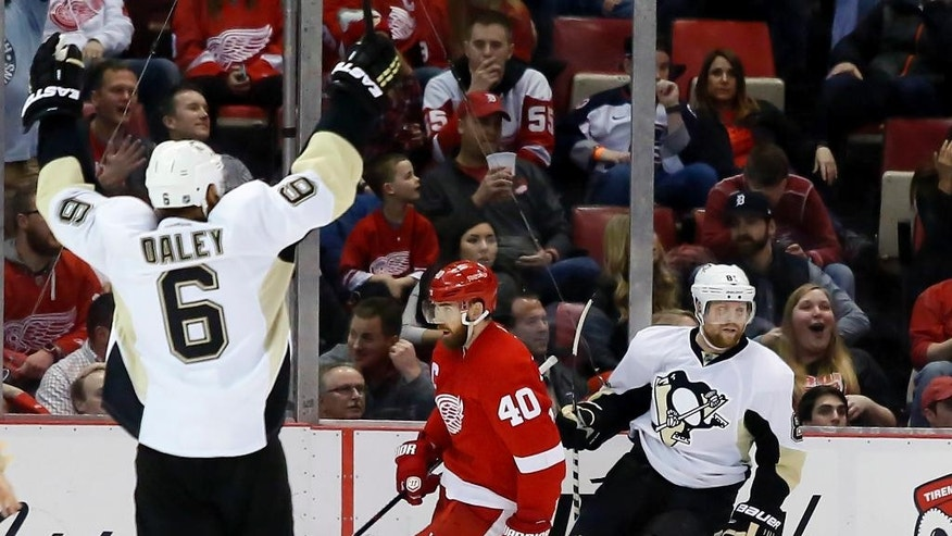 Pittsburgh Penguins' Trevor Daley (6) celebrates a goal by teammate Phil Kessel, right, as Detroit Red Wings' Henrik Zetterberg (40), of Sweden, skates away during the second period of an NHL hockey game Saturday, March 26, 2016, in Detroit. (AP Photo/Duane Burleson)