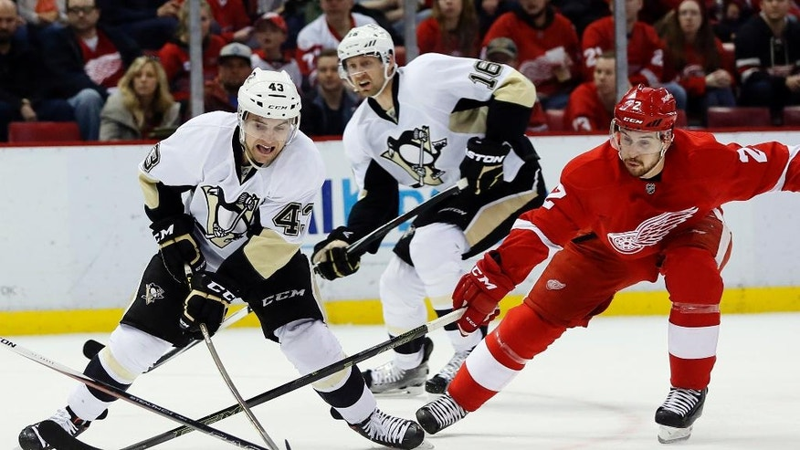 Detroit Red Wings' Brendan Smith (2) tries to steal the puck from Pittsburgh Penguins' Conor Sheary (43) as Penguins' Eric Fehr (16) gives chase during the first period of an NHL hockey game Saturday, March 26, 2016, in Detroit. (AP Photo/Duane Burleson)