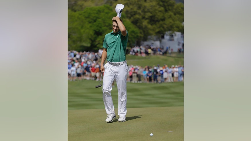 Jordan Spieth reacts after missing a putt on the 16th green during the round of 16 play against Louis Oosthuizen at the Dell Match Play Championship golf tournament at Austin County Club, Saturday, March 26, 2016, in Austin, Texas. Speith lost the hole and the match. (AP Photo/Eric Gay)