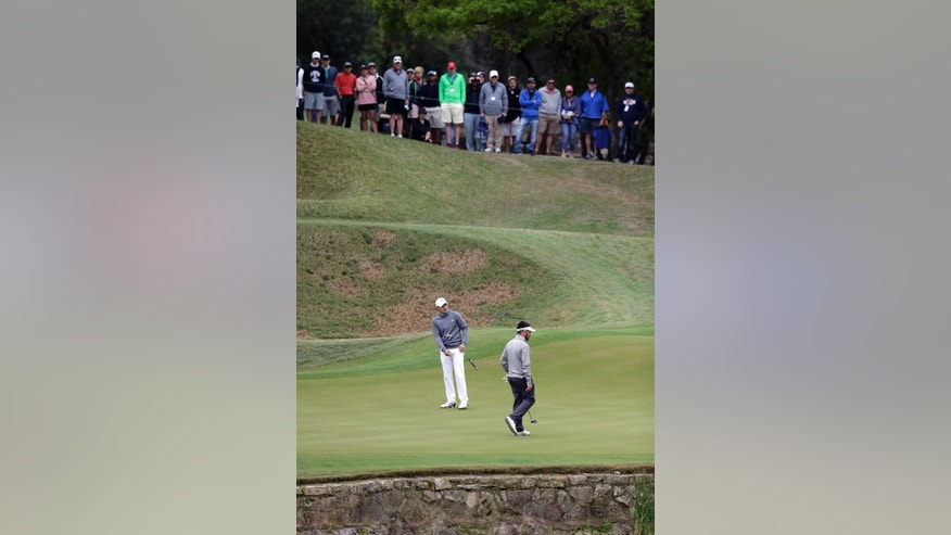 Jordan Spieth, left, and Louis Oosthuizen, right, putt on the on the third green during the round of 16 at the Dell Match Play Championship golf tournament at Austin County Club, Saturday, March 26, 2016, in Austin, Texas. (AP Photo/Eric Gay)