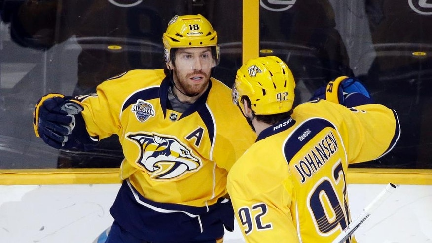 Nashville Predators left wing James Neal, left, celebrates with Ryan Johansen (92) after Neal scored a goal against the Columbus Blue Jackets in the first period of an NHL hockey game Saturday, March 26, 2016, in Nashville, Tenn. (AP Photo/Mark Humphrey)