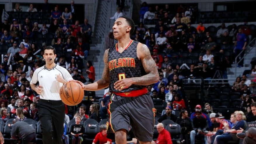 AUBURN HILLS, MI - MARCH 26: Jeff Teague #0 of the Atlanta Hawks drives against the Detroit Pistons during the game on March 26, 2016 at The Palace of Auburn Hills in Auburn Hills, Michigan. NOTE TO USER: User expressly acknowledges and agrees that, by downloading and or using this Photograph, user is consenting to the terms and conditions of the Getty Images License Agreement. Mandatory Copyright Notice: Copyright 2016 NBAE (Photo by B. Sevald/Einstein/NBAE via Getty Images)