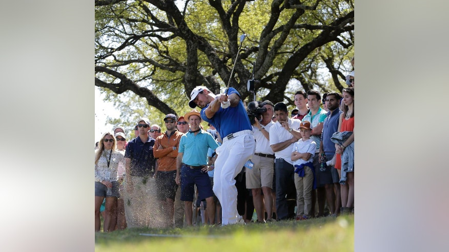 Jason Day, of Australia, hits out of the gallery on the fifth fairway during final round play against Louis Oosthuizen, of South Africa, at the Dell Match Play Championship golf tournament at Austin Country Club Sunday, March 27, 2016, in Austin, Texas. (AP Photo/Eric Gay)
