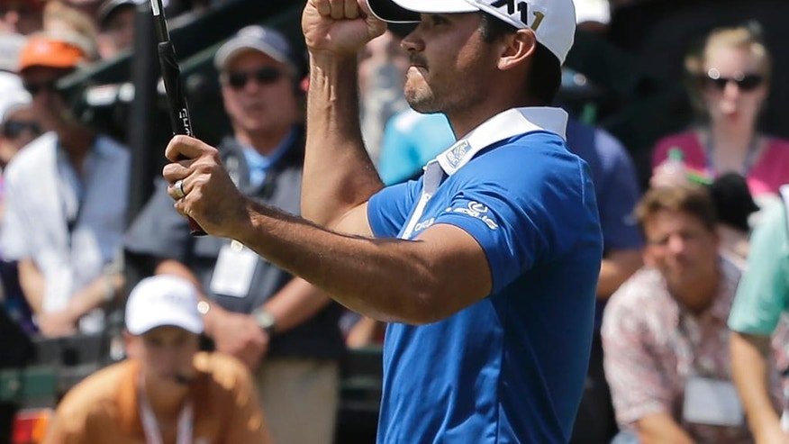Jason Day, of Australia, reacts after sinking a putt to defeat Rory McIlroy, of Northern Ireland, in the semifinal round at the Dell Match Play Championship golf tournament at Austin Country Club, Sunday, March 27, 2016, in Austin, Texas. (AP Photo/Eric Gay)
