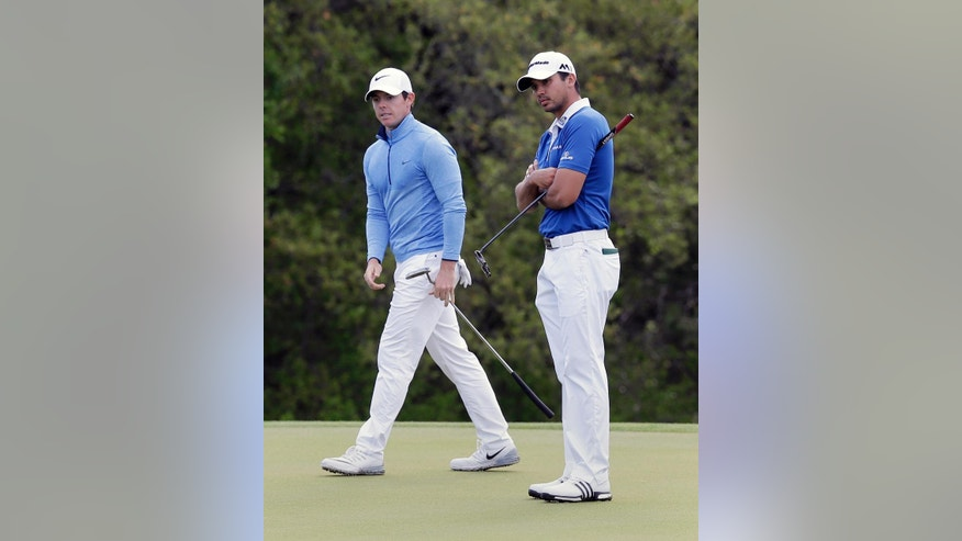 Rory McIlroy, of Northern Ireland, left, and Jason Day, of Australia, right, prepare to putt on the first hole during the semifinal final round at the Dell Match Play Championship golf tournament at Austin County Club, Sunday, March 27, 2016, in Austin, Texas. (AP Photo/Eric Gay)