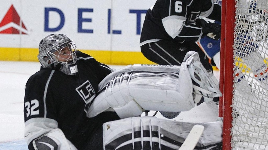 Los Angeles Kings goalie Jonathan Quick falls to the ice to make a save against the Edmonton Oilers during the first period of an NHL hockey game in Los Angeles, Saturday, March 26, 2016. (AP Photo/Alex Gallardo)