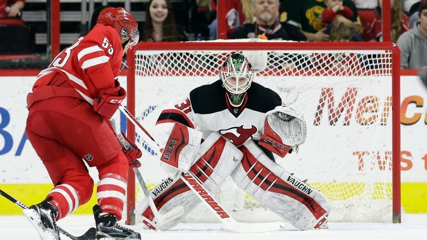 New Jersey Devils goalie Scott Wedgewood (31) keeps an eye on the puck as Carolina Hurricanes' Jeff Skinner (53) looks for a shot during the first period of an NHL hockey game in Raleigh, N.C., Sunday, March 27, 2016. (AP Photo/Gerry Broome)