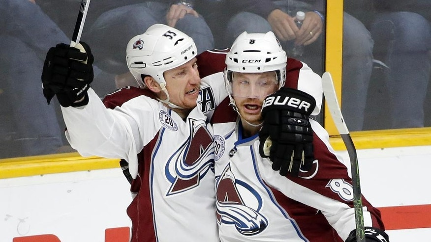 Colorado Avalanche right wing Jack Skille (8) is congratulated by Cody McLeod (55) after Skille scored a goal against the Nashville Predators in the first period of an NHL hockey game, Monday, March 28, 2016, in Nashville, Tenn. (AP Photo/Mark Humphrey)