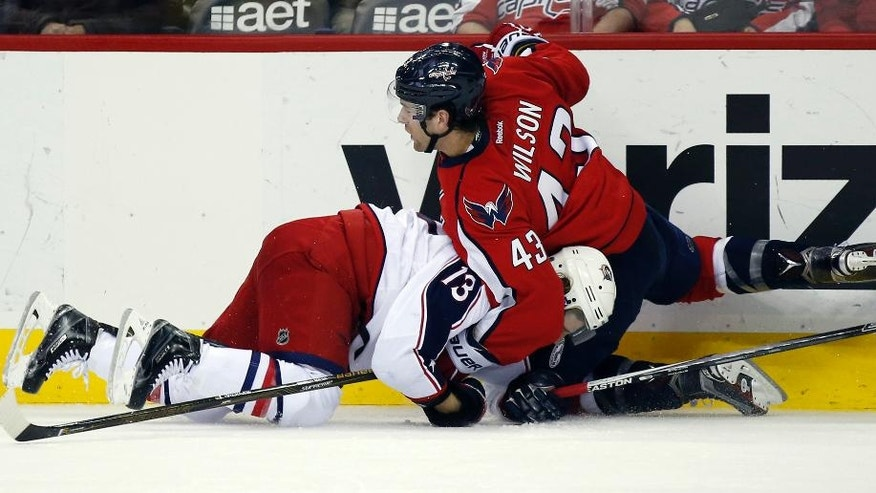 Columbus Blue Jackets right wing Cam Atkinson (13) and Washington Capitals right wing Tom Wilson (43) get tangled up in the second period of an NHL hockey game, Monday, March 28, 2016, in Washington. (AP Photo/Alex Brandon)