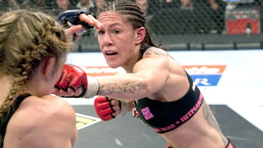 "SUNRISE, FL - JANUARY 30: (R-L) Cristiane ""Cyborg"" Santos punches Marloes Coenen during the Women's Featherweight Championship bout at the Strikeforce Miami event on January 30, 2010 in Sunrise, Florida. (Photo by Esther Lin/Forza LLC/Forza LLC via Getty Images)"