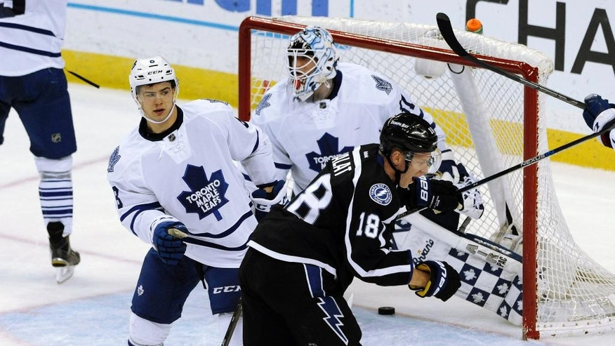 Tampa Bay Lightning's Ondrej Palat (18) celebrates his goal against Toronto Maple Leafs' Garret Sparks, center, and Connor Carrick (8) during the first period of an NHL hockey game, Monday, March 28, 2016, in Tampa, Fla. (AP Photo/Steve Nesius)