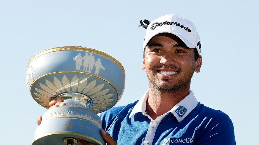 Jason Day, of Australia, holds the trophy after winning the Dell Match Play Championship golf tournament at Austin Country Club, Sunday, March 27, 2016, in Austin, Texas. (AP Photo/Charlie Riedel)