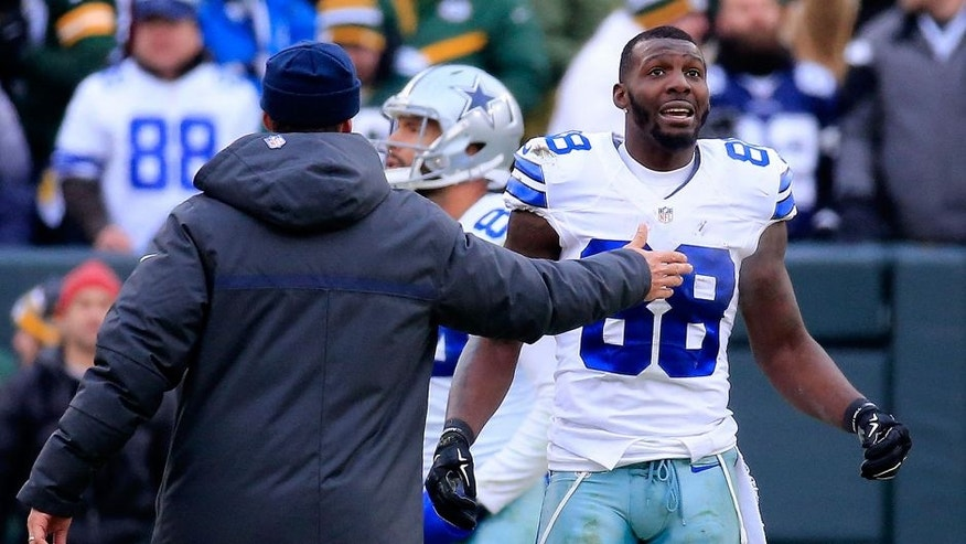 <p>GREEN BAY, WI - JANUARY 11: Dez Bryant #88 of the Dallas Cowboys waits for a replay on a call late in the fourth quarter against the Green Bay Packers during the 2015 NFC Divisional Playoff game at Lambeau Field on January 11, 2015 in Green Bay, Wisconsin. (Photo by Rob Carr/Getty Images)</p>