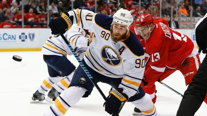 Buffalo Sabres center Ryan O'Reilly (90) wins a face-off against Detroit Red Wings center Pavel Datsyuk (13) in the second period of an NHL hockey game, Monday, March 28, 2016, in Detroit. (AP Photo/Paul Sancya)