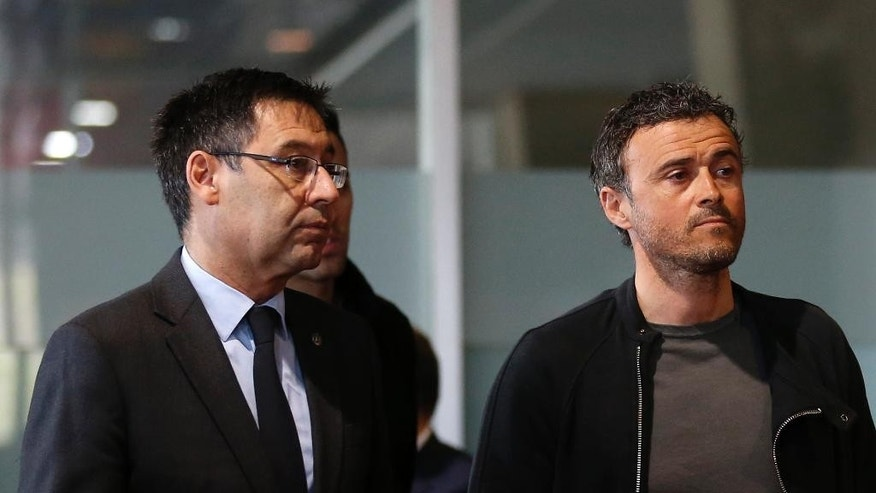 "FC Barcelona's coach Luis Enrique, right, and president Josep Bartomeu arrive to offer their respects to the late Dutch soccer Johan Cruyff at the Camp Nou stadium in Barcelona, Spain, Tuesday, March 29, 2016. Dutch soccer great Johan Cruyff, who revolutionized the game as the personification of ""Total Football,"" has died. He was 68. (AP Photo/Manu Fernandez)"