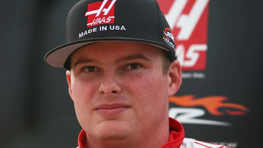 DAYTONA BEACH, FL - FEBRUARY 19: Cole Custer, driver of the #00 Haas Automation Chevrolet, stands on the grid during qualifying for the NASCAR Camping World Truck Series NextEra Energy Resources 250 at Daytona International Speedway on February 19, 2016 in Daytona Beach, Florida. (Photo by Sarah Crabill/NASCAR via Getty Images)