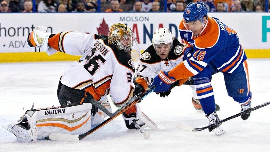 CORRECTS TO SECOND PERIOD- Anaheim Ducks goalie John Gibson (36) makes the save on Edmonton Oilers' Nail Yakupov (10) as Hampus Lindholm (47) defends during second period NHL hockey action in Edmonton, Alberta, Monday, March 28, 2016. (Jason Franson/The Canadian Press via AP)