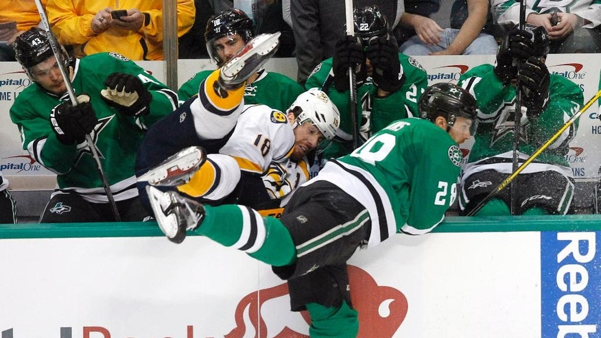 Nashville Predators right wing James Neal (18) is shoved over the railing into the bench by Dallas Stars defenseman Stephen Johns (28) during the first period of an NHL hockey game Tuesday, March 29, 2016, in Dallas.  (AP Photo/Tim Sharp)