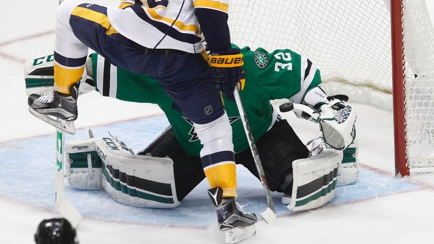 Dallas Stars goalie Kari Lehtonen (32) blocks a shot as he is pressured by Nashville Predators center Ryan Johansen (92) during the first period of an NHL hockey game Tuesday, March 29, 2016, in Dallas.  (AP Photo/Tim Sharp)